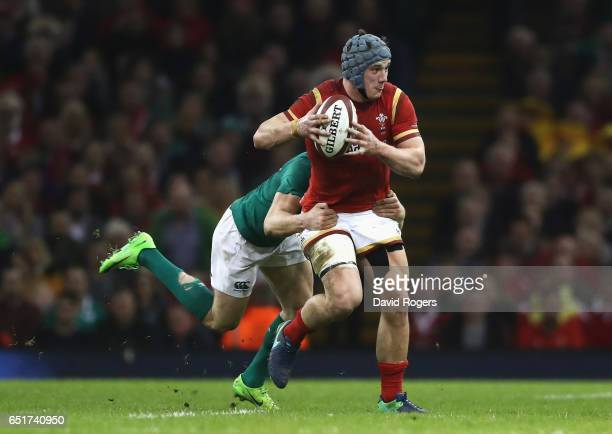 Jonathan Davies of Wales is tackled by Garry Ringrose of Ireland during the Six Nations match between Wales and Ireland at the Principality Stadium...