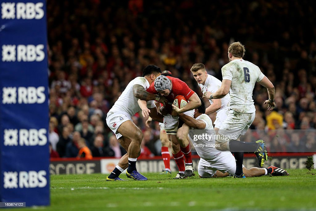 Jonathan Davies of Wales is wrapped up by the England defence during the RBS Six Nations match between Wales and England at Millennium Stadium on March 16, 2013 in Cardiff, Wales.