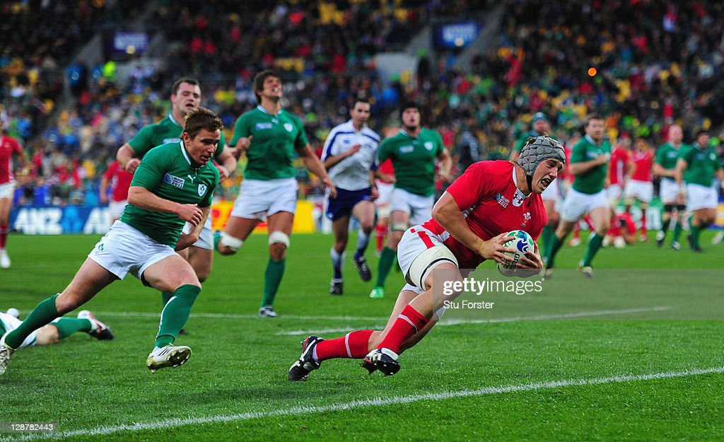 Jonathan Davies of Wales of Wales breaks free from the Ireland defense to score their third try during quarter final one of the 2011 IRB Rugby World Cup between Ireland v Wales at Wellington Regional Stadium on October 8, 2011 in Wellington, New Zealand.