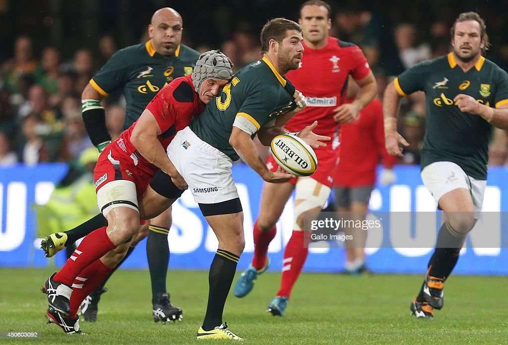 Jonathan Davies of Wales with a tackle on Willie le Roux of South Africa during the Incoming Tour match between South Africa and Wales at Growthpoint Kings Park on June 14, 2014 in Durban, South Africa.