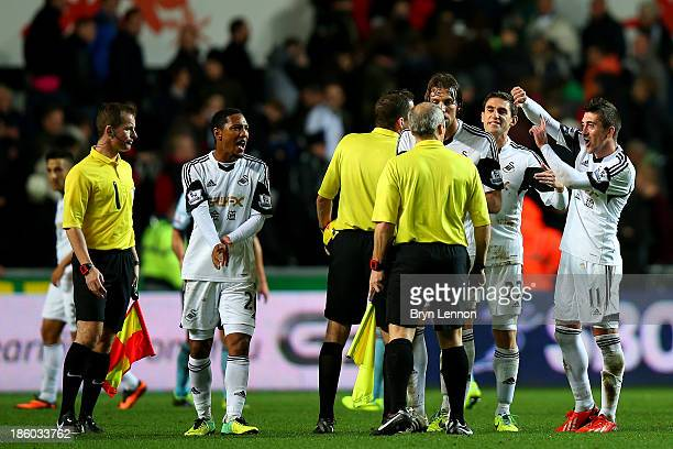 Jonathan de Guzman Miguel Michu Angel Rangel and Pablo Hernandez of Swansea protest to the referee and his assistants after the Barclays Premier...