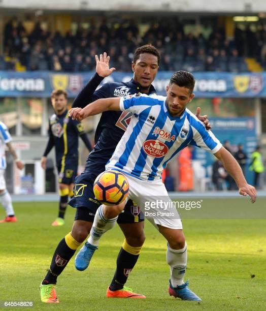 Jonathan De Guzman of ChievoVerona competes with Gianluca Caprari of Pescara Calcio during the Serie A match between AC ChievoVerona and Pescara...