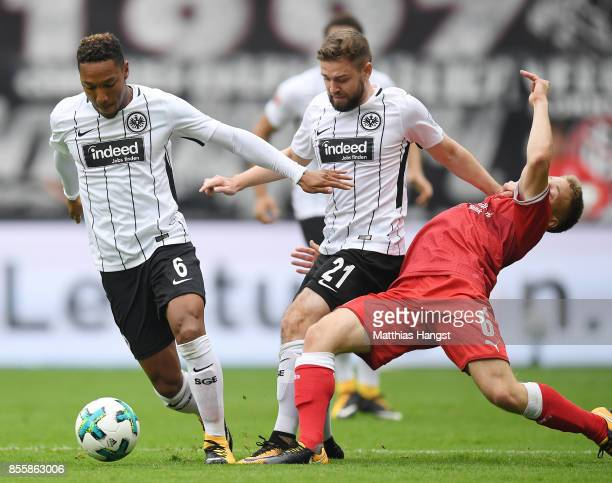 Jonathan de Guzman of Frankfurt Marc Stendera of Frankfurt and Santiago Ascacibar of Stuttgart fight for the ball during the Bundesliga match between...