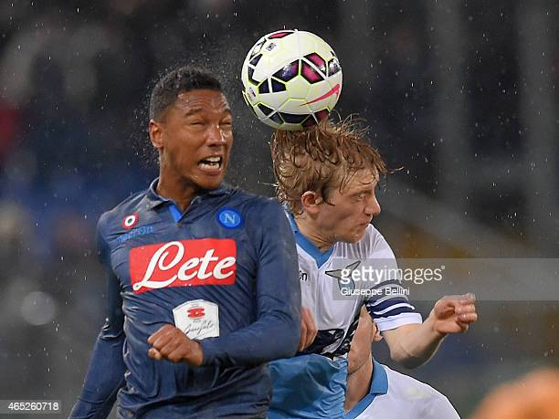 Jonathan De Guzman of SSC Napoli and Dusan Basta of SS Lazio in action during the TIM Cup match between SS Lazio and SSC Napoli at Stadio Olimpico on...