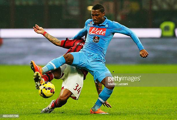 Jonathan De Guzman of SSC Napoli competes for the ball with Nigel De Jong of AC Milan during the Serie A match between AC Milan and SSC Napoli at...