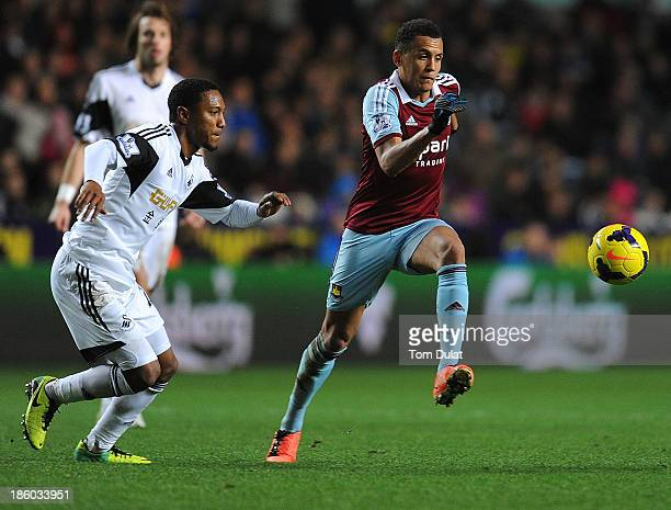 Jonathan de Guzman of Swansea City and Ravel Morrison of West Ham United in action during the Barclays Premier League match between Swansea City and...