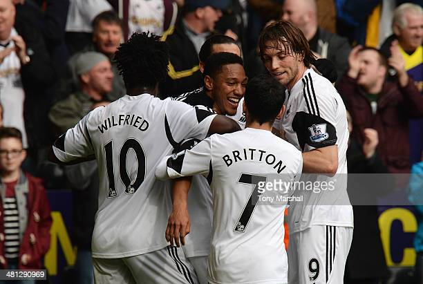 Jonathan de Guzman of Swansea City celebrates the opening goal with team mates during the Barclays Premier League match between Swansea City and...