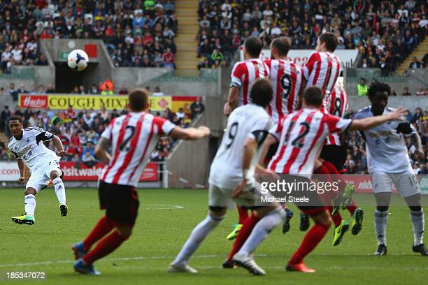 Jonathan de Guzman of Swansea City curls a free kick over the Sunderland wall only to narrowly miss the post during the Barclays Premier League match...