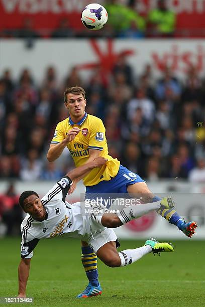 Jonathan de Guzman of Swansea City loses out to a challenge from Aaron Ramsey of Arsenal during the Barclays Premier League match between Swansea...