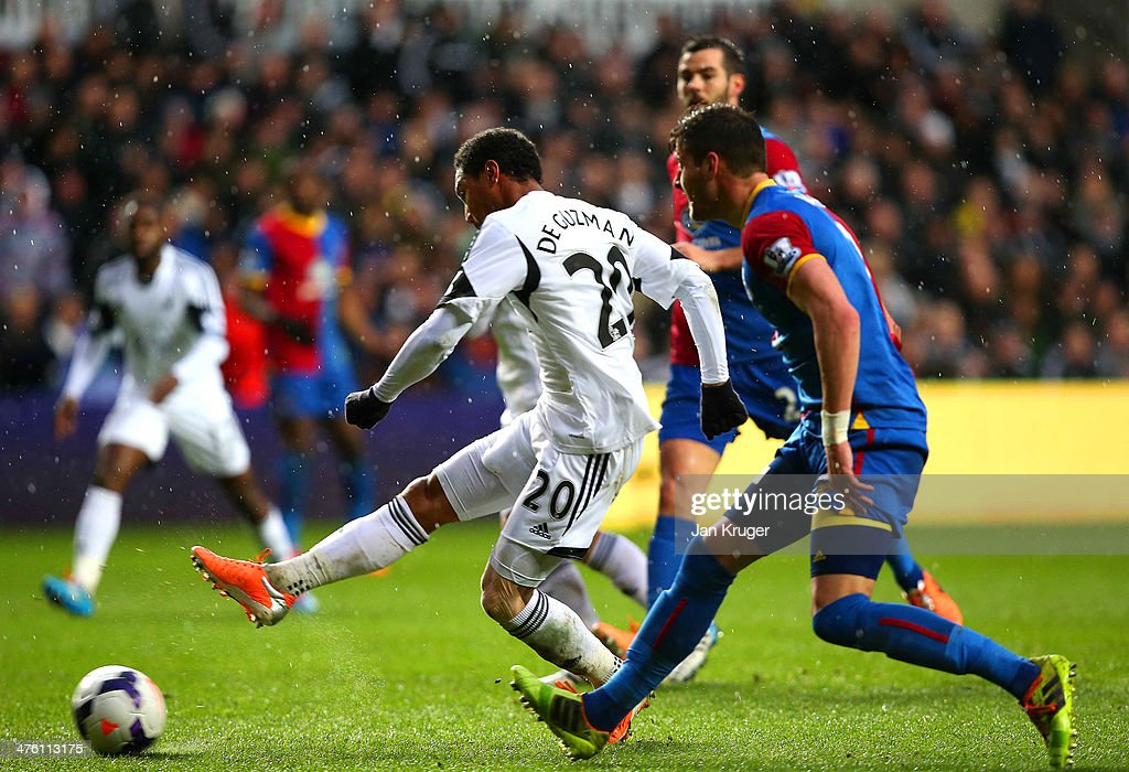 <a gi-track='captionPersonalityLinkClicked' href=/galleries/search?phrase=Jonathan+de+Guzman&family=editorial&specificpeople=674543 ng-click='$event.stopPropagation()'>Jonathan de Guzman</a> of Swansea City scores the opening goal during the Barclays Premier League match between Swansea City and Crystal Palace at Liberty Stadium on March 2, 2014 in Swansea, Wales.