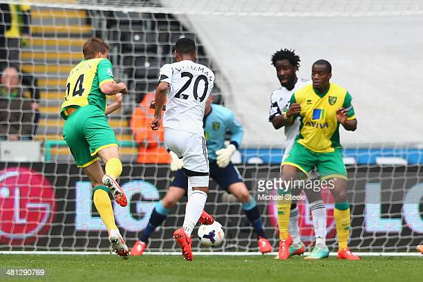 Jonathan de Guzman of Swansea City scores the opening goal during the Barclays Premier League match between Swansea City and Norwich City at the...