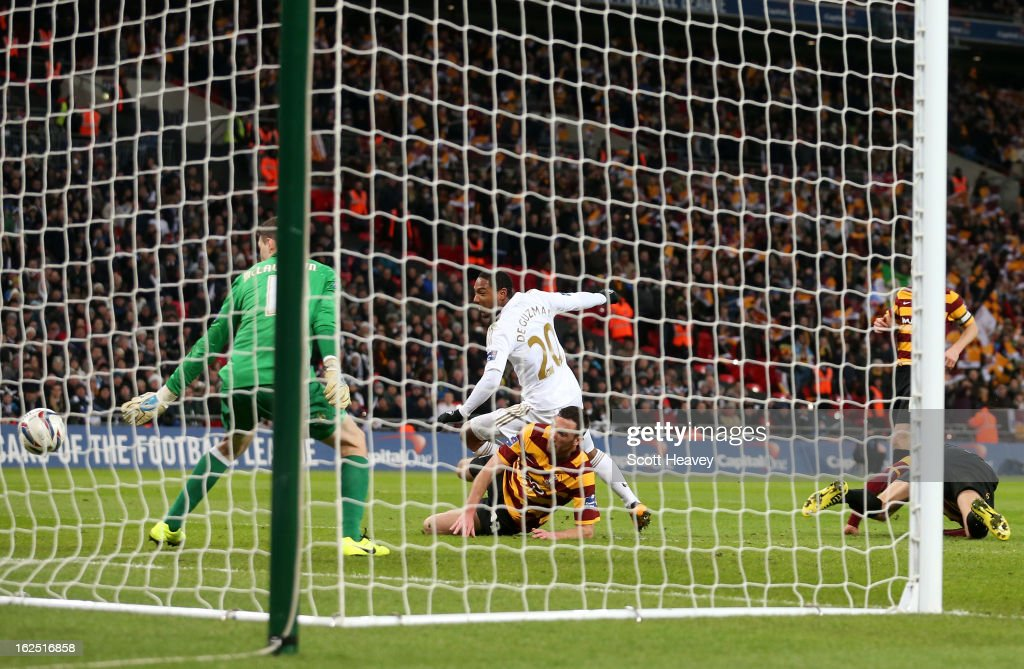Jonathan de Guzman of Swansea City scores their fifth goal during the Capital One Cup Final match between Bradford City and Swansea City at Wembley Stadium on February 24, 2013 in London, England.