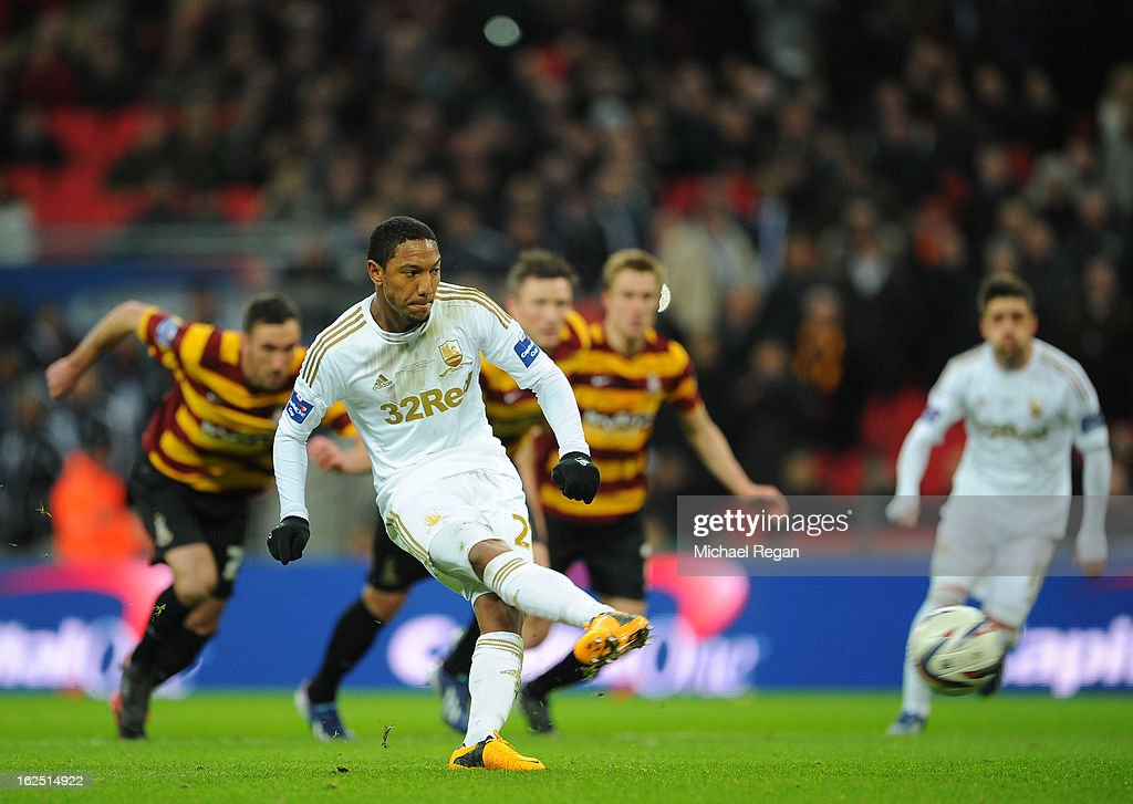 <a gi-track='captionPersonalityLinkClicked' href=/galleries/search?phrase=Jonathan+de+Guzman&family=editorial&specificpeople=674543 ng-click='$event.stopPropagation()'>Jonathan de Guzman</a> of Swansea City scores their fourth goal from the penalty spot during the Capital One Cup Final match between Bradford City and Swansea City at Wembley Stadium on February 24, 2013 in London, England.