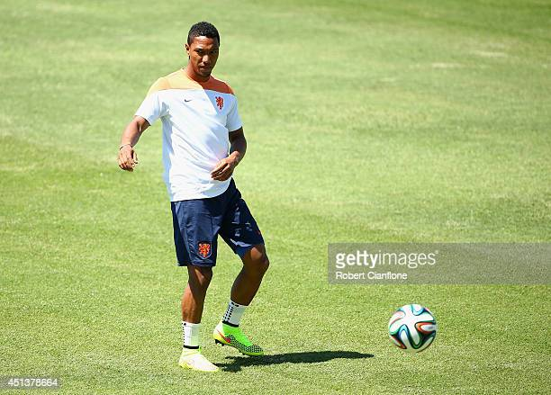Jonathan de Guzman of the Netherlands kicks the ball during the Netherlands training session at the 2014 FIFA World Cup Brazil held at Estadio...