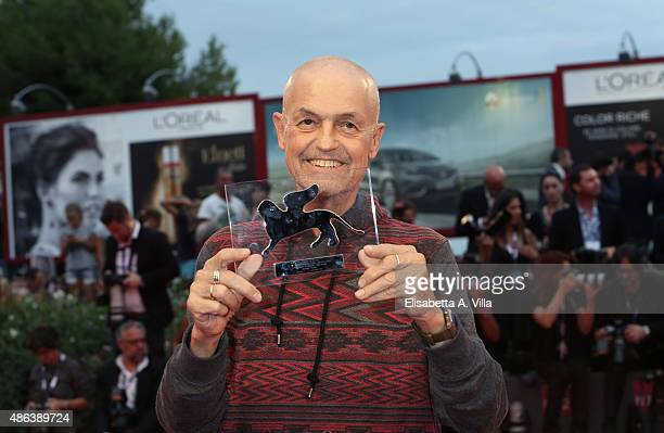 Jonathan Demme poses with his Visionary Talent Award during a premiere of 'Spotlight' during the 72nd Venice Film Festival on September 3 2015 in...