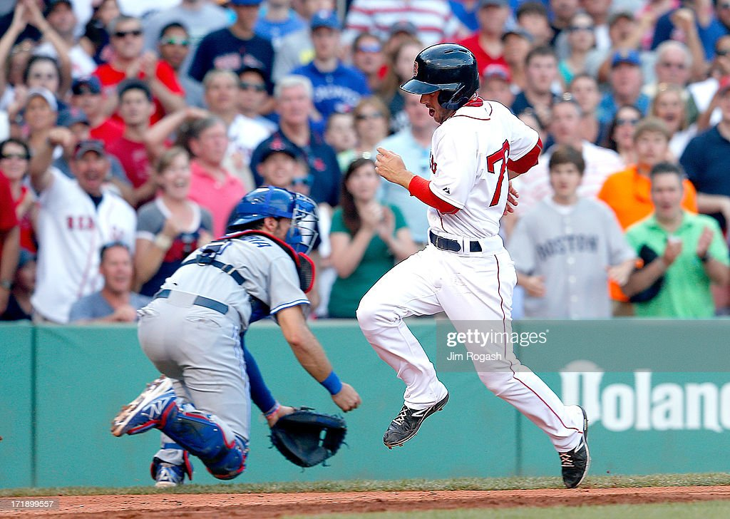 Jonathan Diaz #76 of the Boston Red Sox scores the tying run against the Toronto Blue Jays in the 7th inning at Fenway Park on June 29, 2013 in Boston, Massachusetts.
