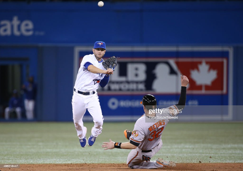 Jonathan Diaz #1 of the Toronto Blue Jays turns a double play in the ninth inning during MLB game action as <a gi-track='captionPersonalityLinkClicked' href=/galleries/search?phrase=Matt+Wieters&family=editorial&specificpeople=4498276 ng-click='$event.stopPropagation()'>Matt Wieters</a> #32 of the Baltimore Orioles slides into second base on April 23, 2014 at Rogers Centre in Toronto, Ontario, Canada.