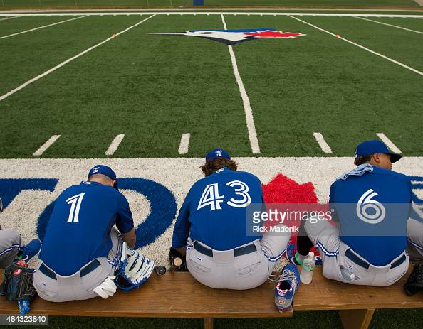 DUNEDIN FEBRUARY 24 Jonathan Diaz RA Dickey and Marcus Stroman put on their shoes as they prepare for the day's practice Pitchers and catchers...