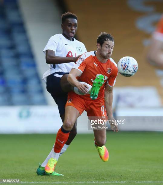 Jonathan Dinzeyi of Tottenham and Danny Hylton of Luton during the Checkatrade Trophy Southern Section Group F match between Luton Town and Tottenham...