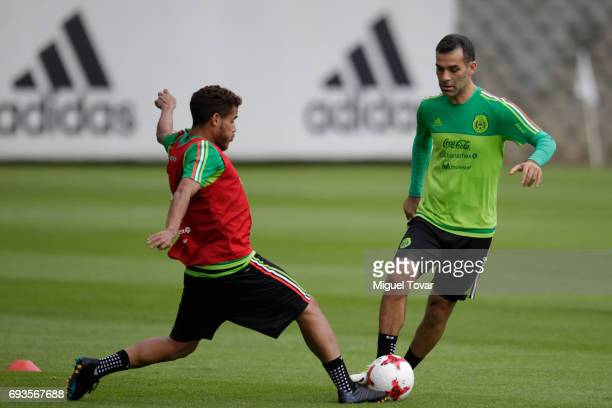 Jonathan Dos Santos fights for the ball with Rafael Marquez during a Mexico national team training session at CAR on June 07 2017 in Mexico City...