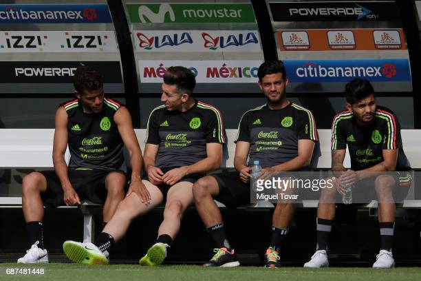 Jonathan Dos Santos Hector Herrera Carlos Vela and Carlos Salcedo of Mexico rest during a training session at Centro Nacional de Desarrollo de...