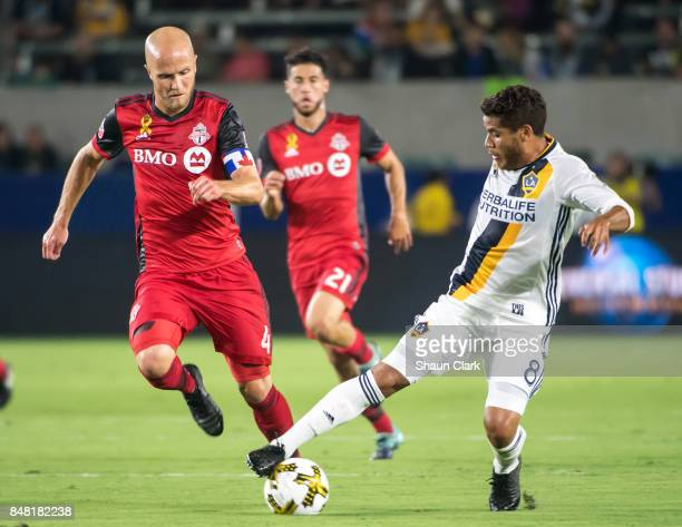 Jonathan dos Santos of Los Angeles Galaxy battles Michael Bradley of Toronto FC during the Los Angeles Galaxy's MLS match against Toronto FC at the...
