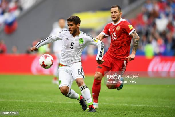 Jonathan Dos Santos of Mexico and Fedor Kudriashov of Russia battle for possession during the FIFA Confederations Cup Russia 2017 Group A match...