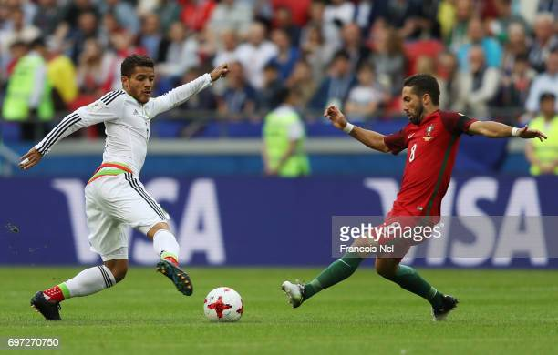 Jonathan Dos Santos of Mexico and Joao Moutinho of Portugal battle for possession during the FIFA Confederations Cup Russia 2017 Group A match...