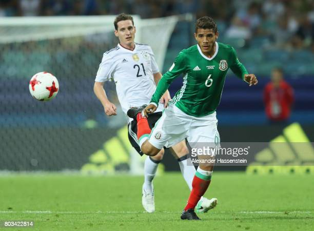 Jonathan Dos Santos of Mexico and Sebastian Rudy of Germany compete for the ball during the FIFA Confederations Cup Russia 2017 SemiFinal between...