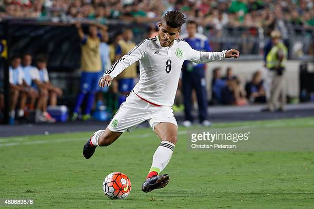Jonathan Dos Santos of Mexico shoots the ball during the 2015 CONCACAF Gold Cup group C match against Guatemala at University of Phoenix Stadium on...