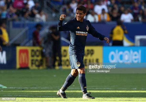 Jonathan dos Santos of the Los Angeles Galaxy reacts after scoring a goal in the first half against Minnesota United FC during the MLS game at...