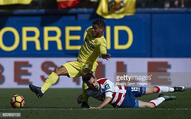 Jonathan Dos Santos of Villarreal competes for the ball with Isaac Cuenca of Granada during the La Liga match between Villarreal CF and Granada CF at...