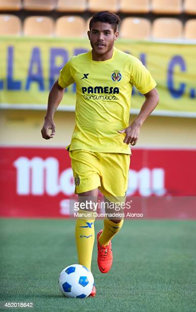 Jonathan Dos Santos runs with the ball during his presentation as a new player for Villarreal CF at the El Madrigal stadium on July 10 2014 in...