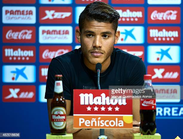 Jonathan Dos Santos speaks during his presentation as a new player for Villarreal CF at the El Madrigal stadium on July 10 2014 in Villarreal Spain