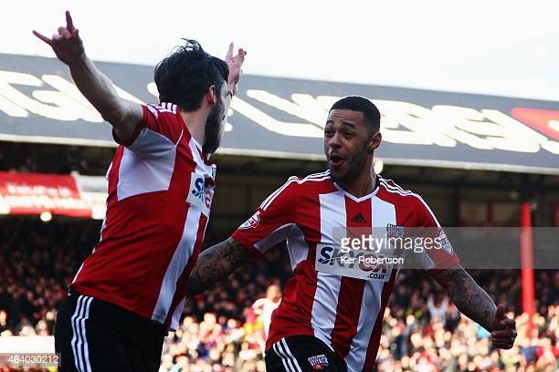 Jonathan Douglas of Brentford celebrates with team mate Andre Gray after scoring during the Sky Bet Championship match between Brentford and AFC...
