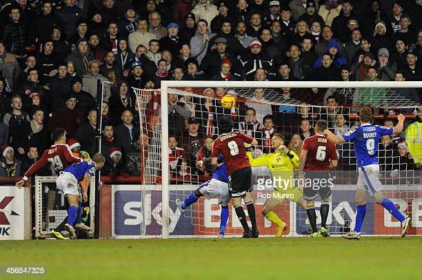 Jonathan Douglas of Brentford scores the opening goal past Brentford goalkeeper David Button during the Sky Bet League One match between Brentford...