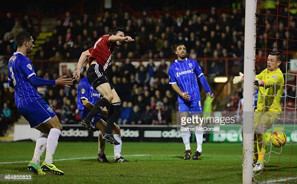 Jonathan Douglas scores a goal for Brentford during the Sky Bet League One match between Brentford and Gillingham at Griffin Park on January 24 2014...