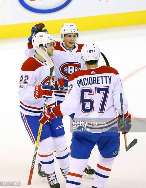 Jonathan Drouin Artturi Lehkonen and Max Pacioretty of the Montreal Canadiens celebrate a first period goal against the Winnipeg Jets at the Bell MTS...