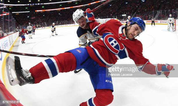Jonathan Drouin of the Montreal Canadiens and Josh Gorges of the Buffalo Sabres battle for position in the NHL game at the Bell Centre on November 11...