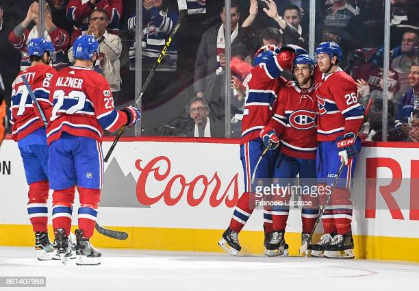 Jonathan Drouin of the Montreal Canadiens celebrates with teammates his goal against the Toronto Maple Leafs in the NHL game at the Bell Centre on...