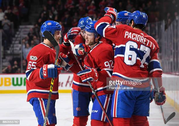 Jonathan Drouin of the Montreal Canadiens celebrates with teammates after scoring a goal against the Columbus Blue Jackets in the NHL game at the...
