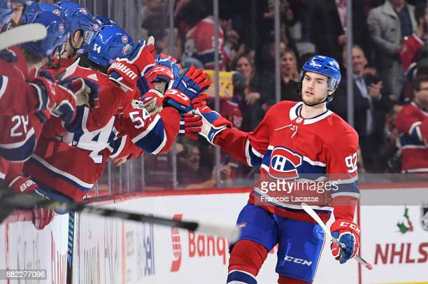 Jonathan Drouin of the Montreal Canadiens celebrates with the bench after scoring a goal against the Ottawa Senators in the NHL game at the Bell...
