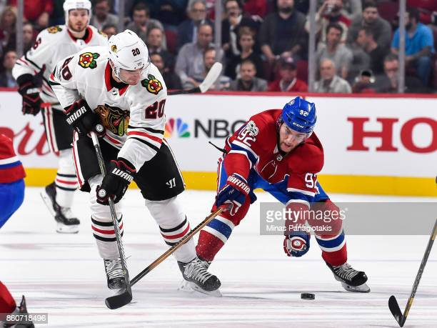 Jonathan Drouin of the Montreal Canadiens challenges Brandon Saad of the Chicago Blackhawks during the NHL game at the Bell Centre on October 10 2017...