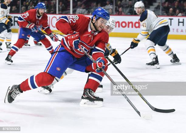 Jonathan Drouin of the Montreal Canadiens controls the puck against Johan Larsson of the Buffalo Sabres in the NHL game at the Bell Centre on...
