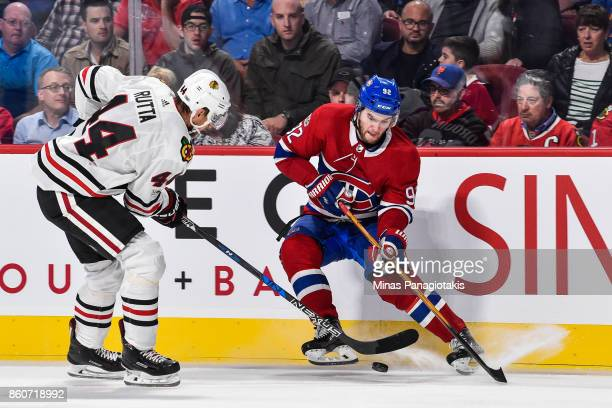 Jonathan Drouin of the Montreal Canadiens defends the puck against Jan Rutta of the Chicago Blackhawks during the NHL game at the Bell Centre on...