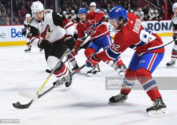 Jonathan Drouin of the Montreal Canadiens fights for the puck against Luke Schenn of the Arizona Coyotes in the NHL game at the Bell Centre on...