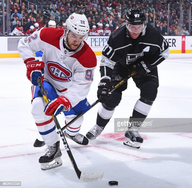 Jonathan Drouin of the Montreal Canadiens handles the puck against Jeff Carter of the Los Angeles Kings at STAPLES Center on October 18 2017 in Los...