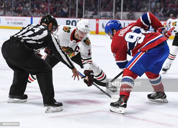 Jonathan Drouin of the Montreal Canadiens prepares for a faceoff against Jonathan Toews of the Chicago Blackhawks in the NHL game at the Bell Centre...