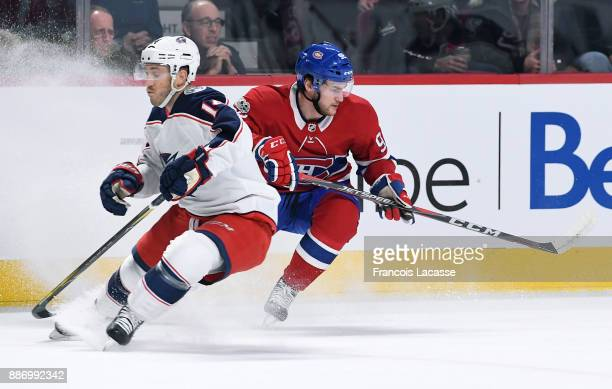 Jonathan Drouin of the Montreal Canadiens skates against Jordan Schroeder of the Columbus Blue Jackets in the NHL game at the Bell Centre on November...