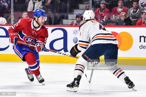 Jonathan Drouin of the Montreal Canadiens skates against Kris Russell of the Edmonton Oilers during the NHL game at the Bell Centre on December 9...